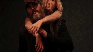 Joaquin Phoenix's Joe helps Ekaterina Samsonov's Nina escape sex traffickers. (Photo via IMDB.com.)