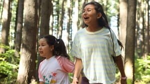 A still from 'Beans.' Two young Mohawk girls are in a wooded area, appearing to be yelling out of fear, concern