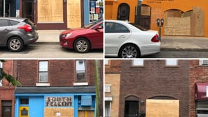 After a weekend in crisis across the city, boarded-up businesses line East Passyunk Avenue. (Photos by Alaina Johns.)
