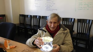 Freeman Dyson beholds Luci, a self-contained solar-power lighting device. (Photo by Esther Dyson via Creative Commons/Flickr)