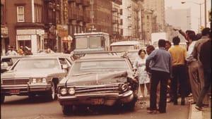 "Belief systems crash. (""Harlem Traffic Accident,"" Chester Higgins, 1973; National Archives)"