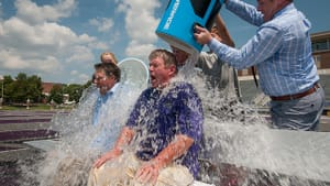 The president (right) and athletic director (left) of the University of Central Arkansas take part in the ALS ice bucket challenge. (Photo via Creative Commons/Flickr)