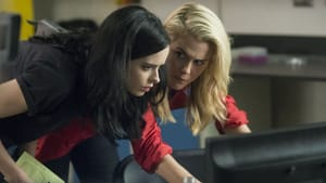 Women working together to bring down the villain: Ritter, Taylor. (Photo by Myles Aronowitz/Netflix)