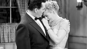 Ricky (Desi Arnaz) comforts Lucy (Lucille Ball) after yet another of her plots to escape her housewife existence meets an ignominious end.