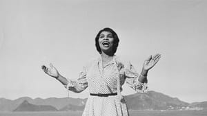 Marian Anderson sings with open arms in front of a mountainous backdrop. (Photo courtesy of Penn Libraries.)