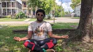 Yoga is a source of rest for Kyle V. Hiller. So is sitting in the sun with his shades. (Photo by Holly Yokley.)